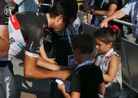 Clasica San Sebastian 2012: RadioShack's Hayden Ralston signs autographs for young fans