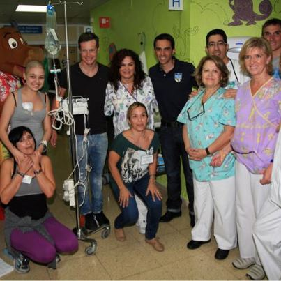 Alberto and team mates visit a children's hospital