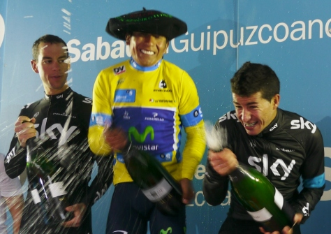 Give that man a big floppy hat! Quintana celebrates his Pais Vasco win with Henao b his side. Porte looks on, amazed. (image: Richard Whatley)