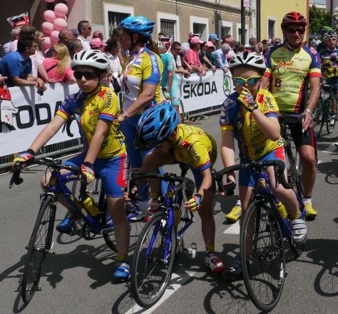 Bunch of local kids excited to leading the peloton out of town