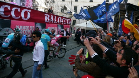 The victor en route to the podium acknowledges his fan club (image: Richard)