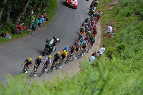 Froome (in yellow) spent most of the day on the back foot as he was forced to track Movistar's attacks on his own (Image: ASO)