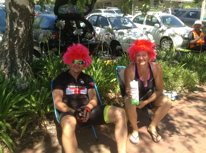 This couple from Perth have solved the problem of helmet hair - wigs