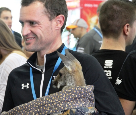 Team Sky proving they're not immune to the lure of cute animals (image: Richard Whatley)